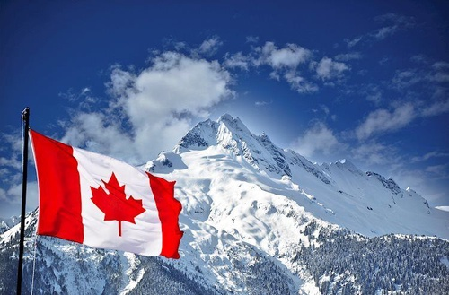 https%3A%2F%2Feditorial.azureedge.net%2Fimages%2FMacroeconomics%2FCountries%2FAmerica%2FCanada%2Fcanada flag and mountain landscape 28337442 Large